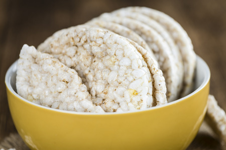 cutouts: Portion of Rice Cakes (close-up shot) on wooden background Stock Photo
