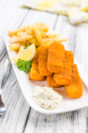 Fried Fish Fingers (selective focus) on wooden background (selective focus) Stock Photo