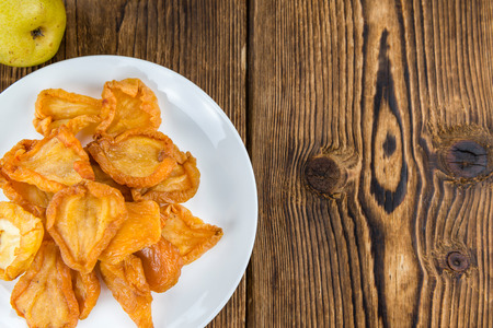 Wooden table with dried Pears (selective focus; close-up shot) Stock Photo