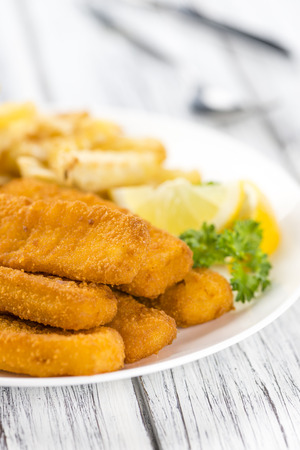 fishfinger: Portion of Fish Fingers (selective focus) on wooden background