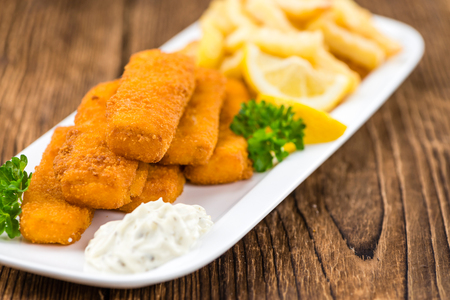fingers: Fried Fish Fingers (selective focus) on wooden background (selective focus) Stock Photo