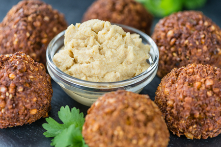 garbanzos: Homemade Falafel (close-up shot; selective focus) on wooden background