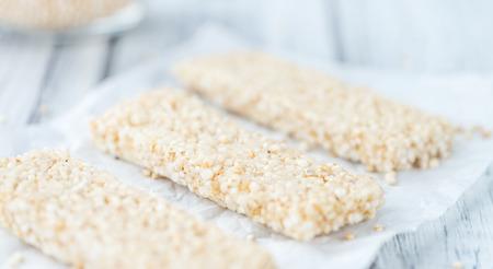 Portion of homemade Quinoa Bars (selective focus; close-up shot) Stock Photo