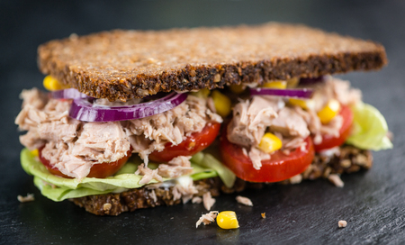 Tuna sandwich with wholemeal bread (selective focus; close-up shot)