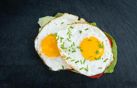 huevos estrellados: Fresh made Sandwich with fried Eggs (close-up shot; selective focus) Foto de archivo