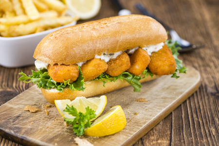 fishfinger: Sandwich with Fish Sticks (selective focus) on an old wooden table