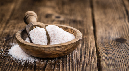 himalayan salt: Pink Himalayan Salt on rustic wooden background (close-up shot)