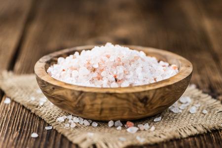 granule: Pink Salt on a vintage background as detailed close-up shot (selective focus) Stock Photo