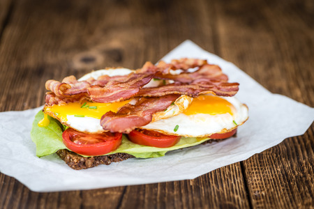 Fresh made Bacon and Egg Sandwich (selective focus; close-up shot)