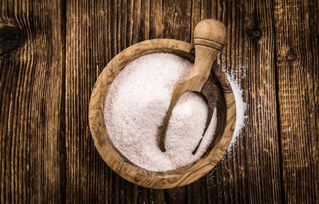himalayan salt: Himalayan Salt as high detailed close-up shot on a vintage wooden table (selective focus)