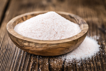 detailed shot: Pink Salt on a vintage background as detailed close-up shot (selective focus) Stock Photo