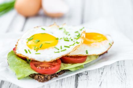 huevos estrellados: Some Fried Eggs on a Sandwich (close-up shot; selective focus)