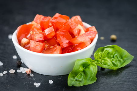 Some fresh Diced Tomatoes on a vintage slate slab (selective focus; close-up shot) Stock Photo