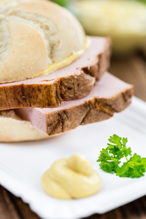Leberkaese on a vintage background as detailed close-up shot (selective focus) Stock Photo
