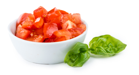 Fresh made Tomatoes (diced) isolated on white background (close-up shot)