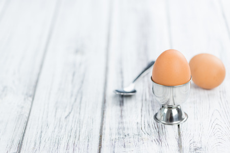 boiled eggs: Wooden table with boiled Eggs (selective focus; close-up shot)