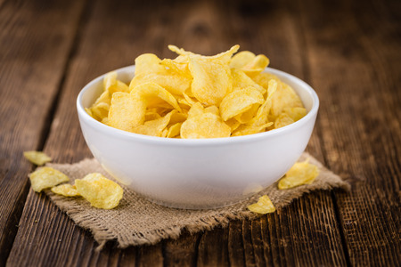 Cheese and Onion Potato Chips on a vintage background as detailed close-up shot (selective focus) Stock Photo