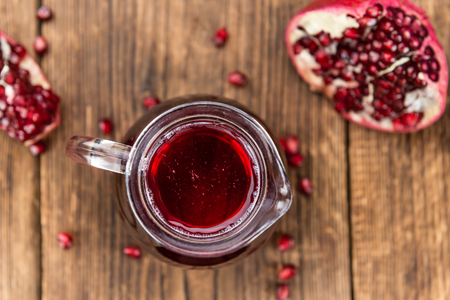 pomegranat: Fresh made Pomegranate juice on a vintage background (close-up shot)