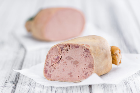 German Leberwurst on an old wooden table as detailed close-up shot (selective focus) Stock Photo