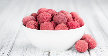 Portion of fresh Lychees (close-up shot; selective focus)