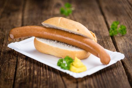 weenie: Sausages (Frankfurter) on rustic wooden background (close-up shot)