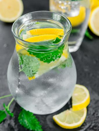 lemon balm: Some Lemonade (with Balm) on a slate slab (close-up shot; selective focus)