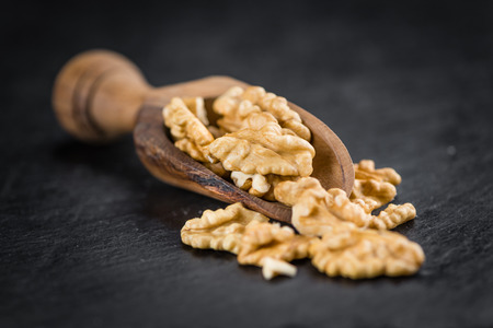 legumbres secas: Portion of Walnuts (kernels) as detailed close up shot on a slate slab (selective focus) Foto de archivo