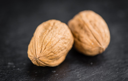 Walnuts on a vintage background as detailed close-up shot (selective focus)