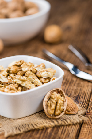 nutshells: Walnut kernels on a vintage background as detailed close-up shot (selective focus) Stock Photo