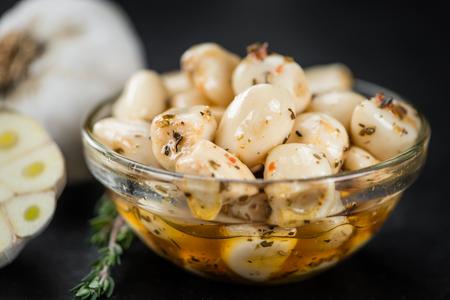 Fresh made Garlic (preserved) on a vintage background (close-up shot)