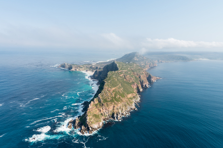 The famous Cape Point (South Africa) aerial view shot from a helicopter (with cape of good hope in the background) Stock Photo