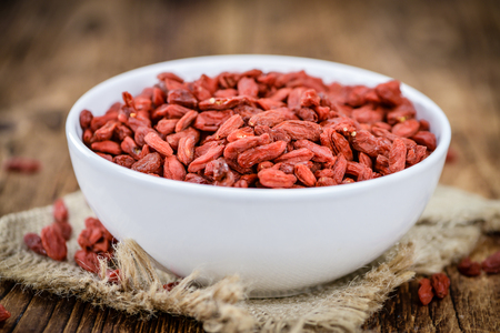 chinese wolfberry: Goji Berries on a vintage background as detailed close-up shot (selective focus) Stock Photo