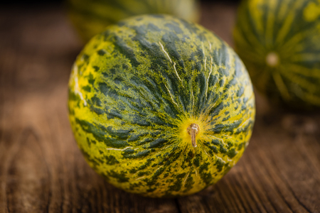 detailed shot: Fresh Futuro Melon as high detailed close-up shot on a vintage wooden table (selective focus) Stock Photo