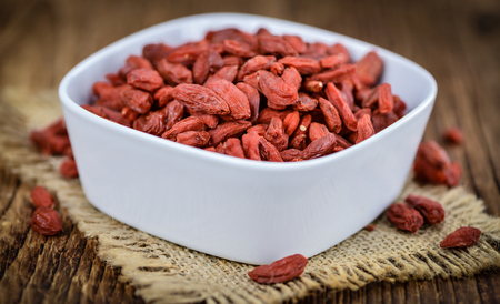chinese wolfberry: Fresh made Dried Goji Berries on a vintage background (close-up shot)