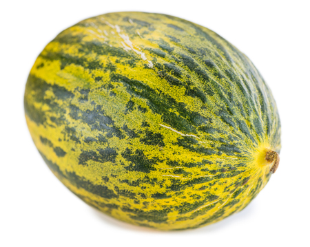 Portion of Futuro Melons (as close-up shot) isolated on white background