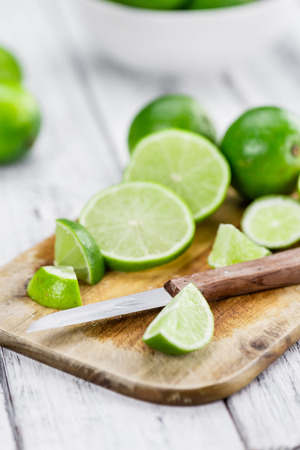 cutted: Sliced Limes (selective focus, close-up shot) Stock Photo