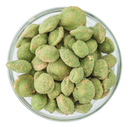 Portion of Wasabi Peanuts (as close-up shot) isolated on white background