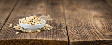 Pine Nuts on a vintage background as detailed close-up shot (selective focus)