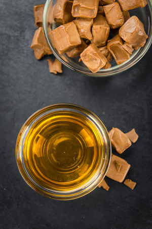 molasses: Caramel Sirup on a vintage background as detailed close-up shot (selective focus) Stock Photo