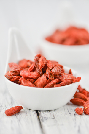 detailed shot: Goji Berries on a vintage background as detailed close-up shot (selective focus) Stock Photo