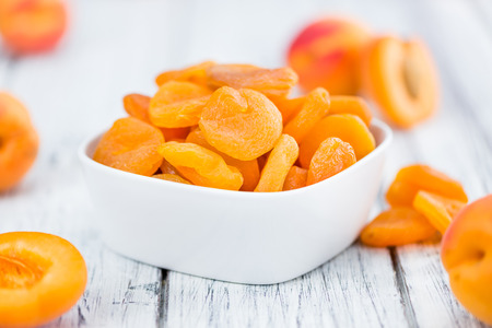 Dried Apricots on a vintage background as detailed close-up shot (selective focus) Stock Photo