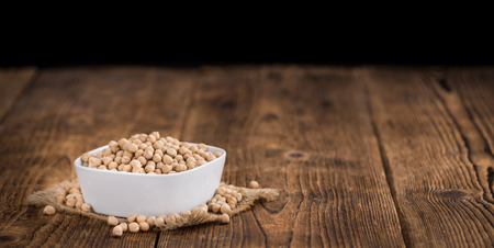 garbanzos: Chickpeas on a vintage background as detailed close-up shot, selective focus