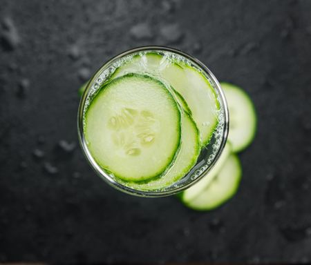 Cucumber Water on a vintage background as detailed close-up shot, selective focus