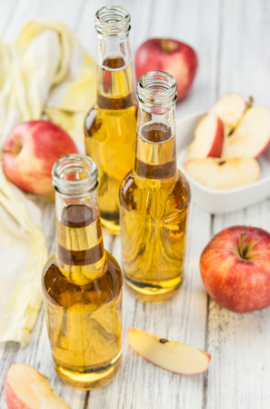 Apple Cider on a vintage background as detailed close-up shot (selective focus)