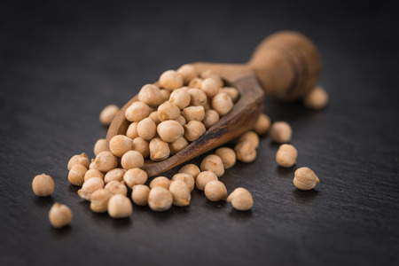Some dried Chickpeas on a slate slab as detailed close-up shot; selective focus Stock Photo