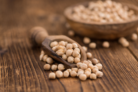 Chickpeas on a vintage background as detailed close-up shot, selective focus