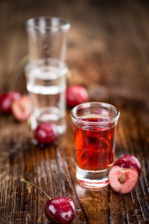 Some homemade Cherry Liqueur as detailed close-up shot, selective focus
