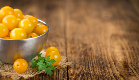 Yellow Tomatoes on a vintage background as detailed close-up shot, selective focus