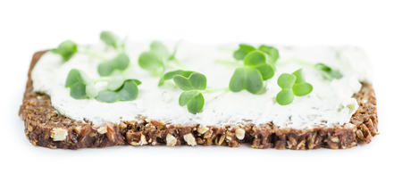 Cress with Cheese on a slice of bread (selective focus; close-up shot) isolated on white background