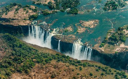 Victoria Falls in Zimbabe at dry time as aerial shot made out of a helicopter